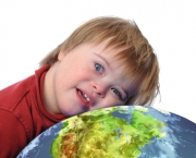 Boy with down syndrome and earth